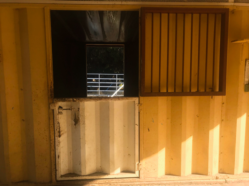 Shipping container barn before